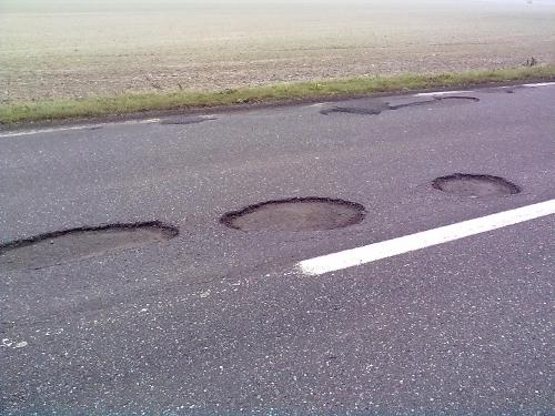 buchi asfalto strada