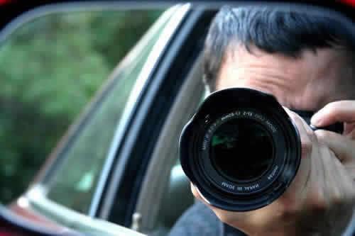 detectitve investigatore spia foto obiettivo